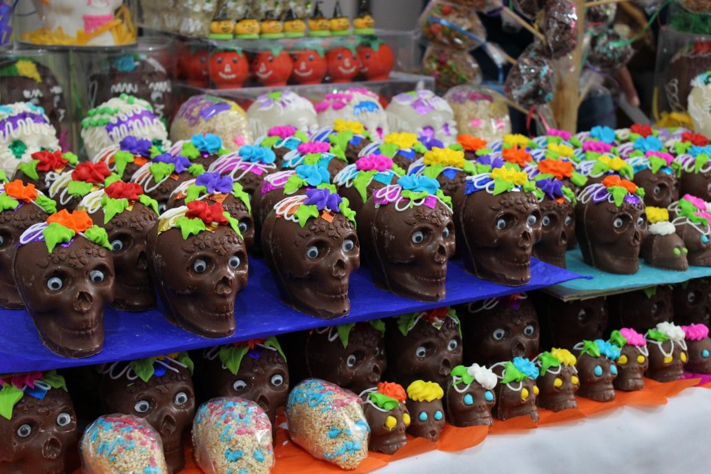 Little skulls made of chocolate on display