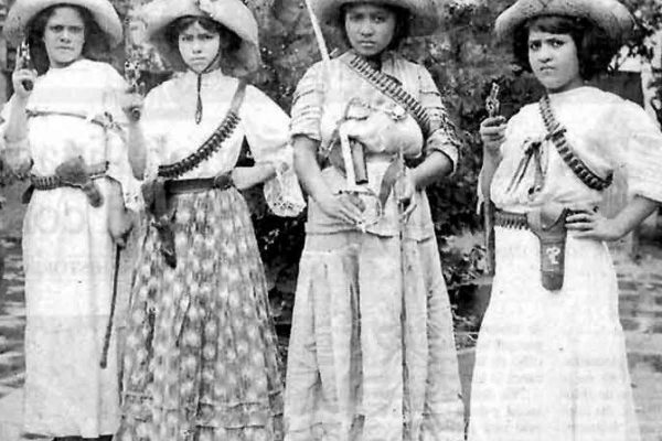 Mexican women from the Mexican Revolution carrying pistols in their hands.