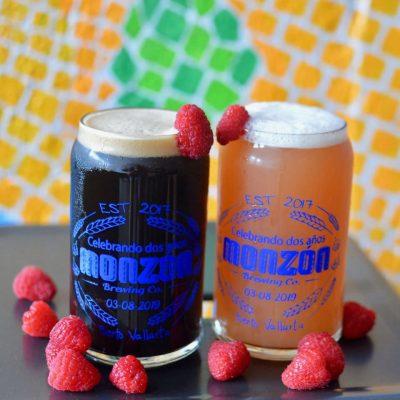 two pints of ale in raspberry chocolate flavors.