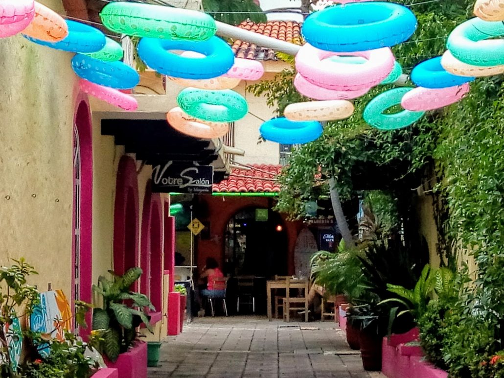 a colorful entrance to the twisted palms roof top lounge.