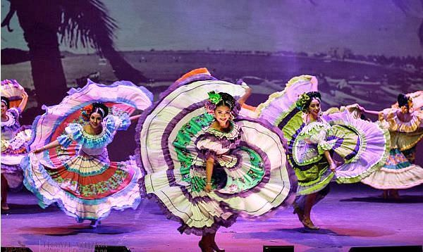 Women in colorful costumes performing a Mexican Folk Dance in Puerto Vallarta Mexico