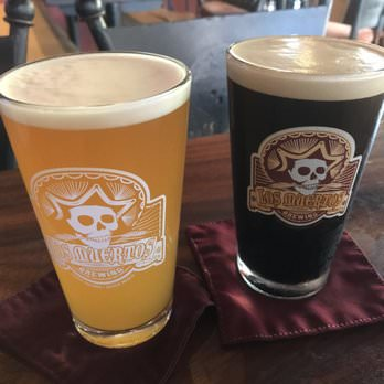 two pints of ales from los muertos brewing.