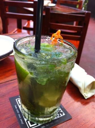 a glass filled with joe jacks famous mojito.