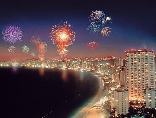 fireworks bursting along the coastline of puerto vallarta on new-year'seve