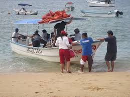a water taxi loading people from the beach in Boca de Tomatlan