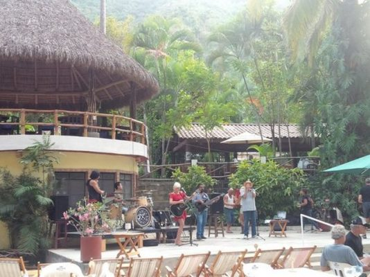 The garden setting and sound stage where musicians play at El Rio in Paso Ancho, Puerto Vallarta.