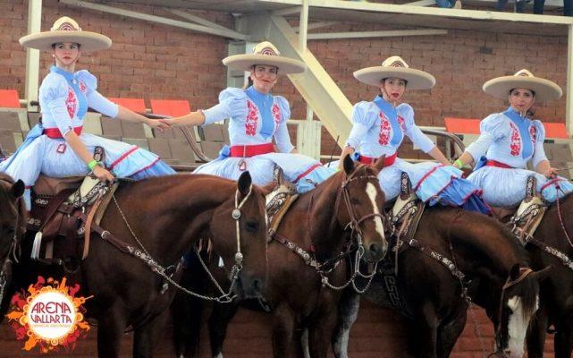 mexican women on horses in charro attire.