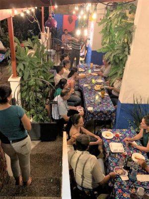 patrons gathered around tables on the patio of la fina cocina de barrio in puerto vallarta
