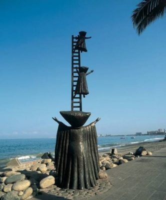 a bronze sculpture of three alien beings on a ladder.