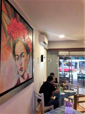 patrons at a table in monos bichis restaurant in puerto vallarta