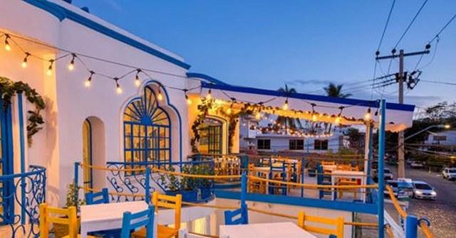 dining tables on a terrace in Mykonos Restaurant in Puerto Vallarta
