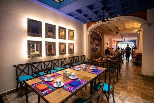 A table set with colorful placemats in restaurant Poblanos Cocina Mexicana in Puerto Vallarta.