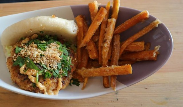 chicken bao with sweet potato fries on a plate