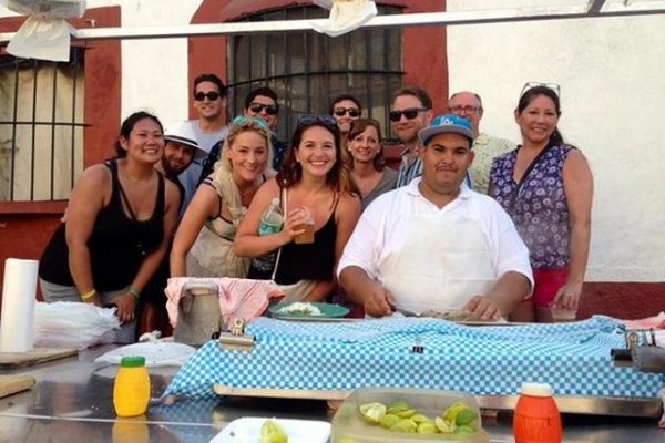 Vallarta Food Tours group of people gather around a taco stand in Puerto Vallarta Mexico