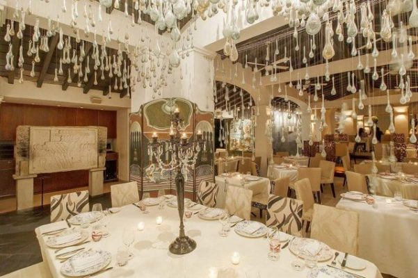 dining room with many glass drops dangling from the ceiling
