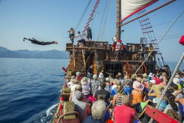 tourists enjoing a pirateship theater performance in Puerto Vallarta