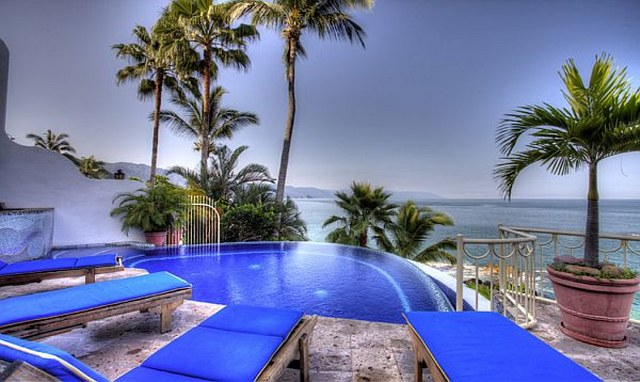 a private swimming pool and palm trees and views of the bay of banderas