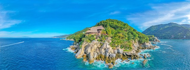 aerial view of Le Kliff restaurant perched on a rocky shoreline above the Pacific Ocean near Puerto Vallarta