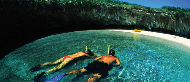 a couple snorkeling in the Mariettas Islands in Puerto Vallarta