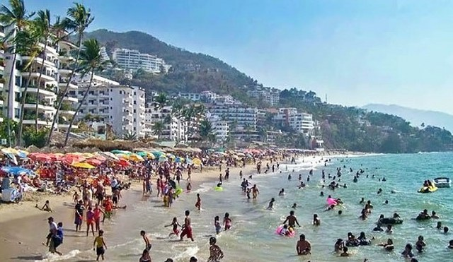 Crowds enjoy easter vacation on the beach in Puerto Vallarta