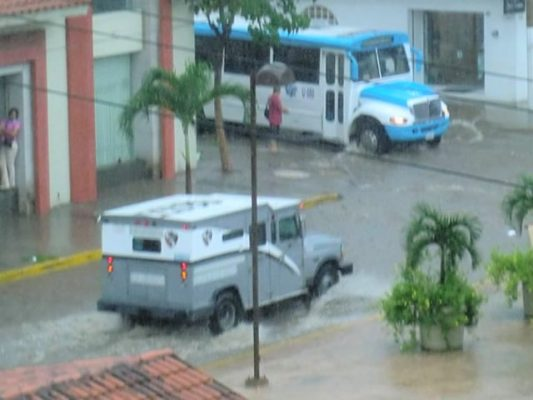 Sreets in downtown Puerto Vallarta are flooded with rain water.